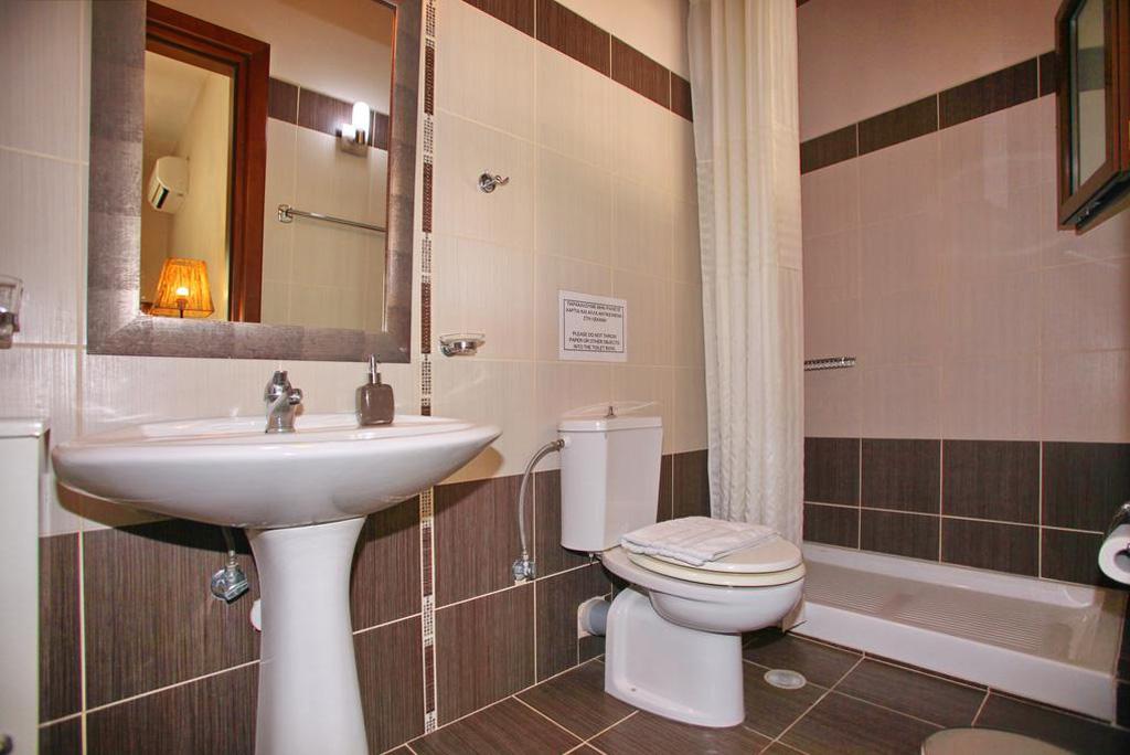 villa amaryllis ground floor bedroom king size bed with private bathroom kardous villas skopelos greece