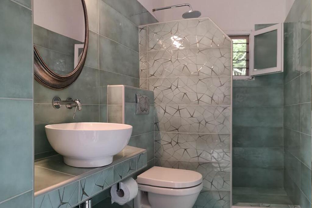 villa pine trees bedroom king size bed bathroom kardous villas skopelos greece